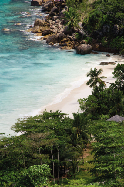 Four Season Resort Seychelles TUI Hotel Blog Fernreise Strand Meer Seychellen Ausblick Palmen Klippe